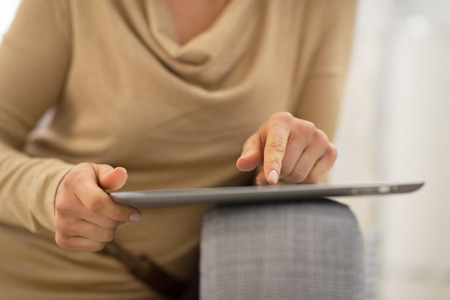 Closeup on young woman using tablet pc