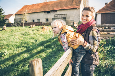 Portrait of happy mother and child on farm Stock Photo