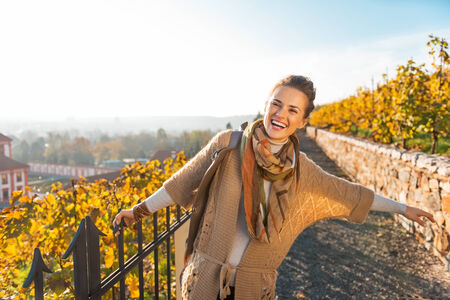 Portrait of happy young woman in autumn outdoors Stock Photo