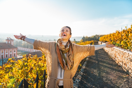 Happy young woman in autumn outdoors rejoicing Stock Photo