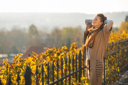 Portrait of relaxed young woman in autumn outdoors Stock fotó