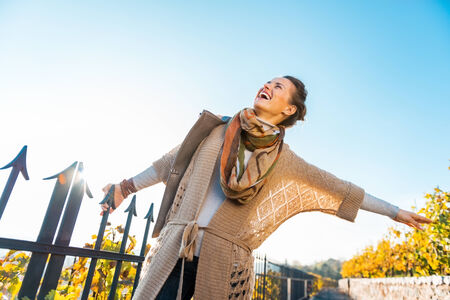 young leaves: Happy young woman having fun time in autumn outdoors Stock Photo