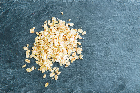 substrate: Closeup on oatmeal on stone substrate Stock Photo