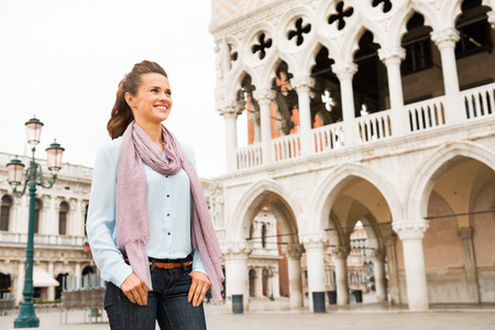 doges: Happy young woman near doges palace in venice, italy Stock Photo