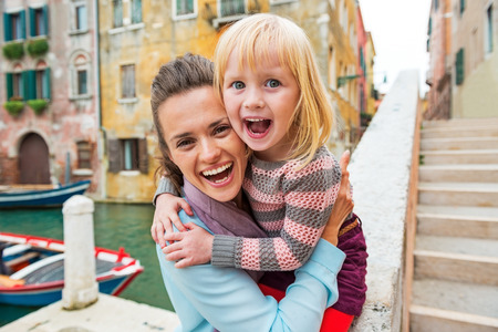 Portrait of happy mother and baby girl in venice, italy Stock Photo