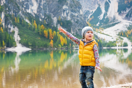 south space: Child pointing on copy space while on lake braies in south tyrol, italy