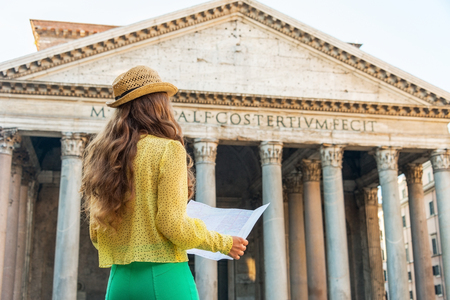 pantheon: Young woman looking at map in front of pantheon in rome, italy. rear view