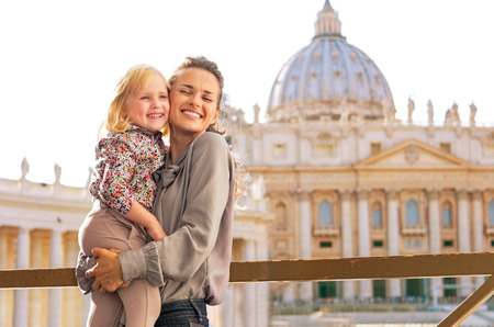 pietro: Portrait of happy mother and baby girl hugging on piazza san pietro in vatican city state