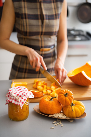 pickling: Closeup on young housewife cutting pumpkin for pickling