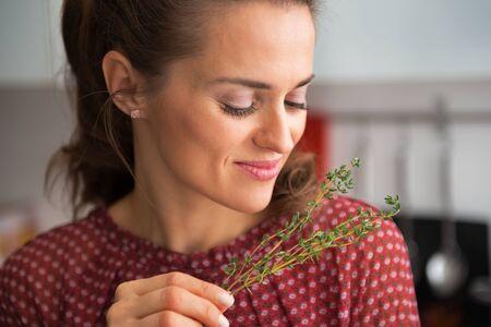 thymus: Portrait of young housewife enjoying fresh thymus