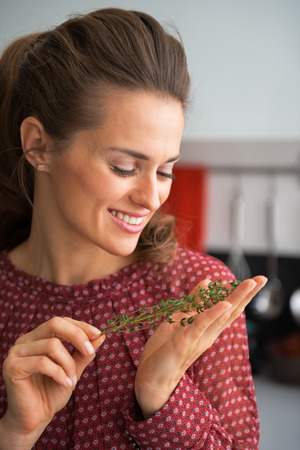 thymus: Young housewife holding fresh thymus Stock Photo