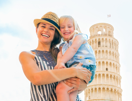 mam: Portrait of smiling mother and baby girl in front of leaning tower of pisa, tuscany, italy