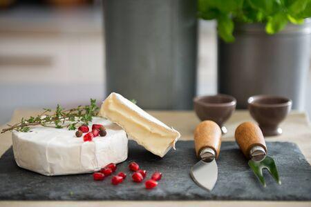 camembert: Closeup on camembert on table Stock Photo