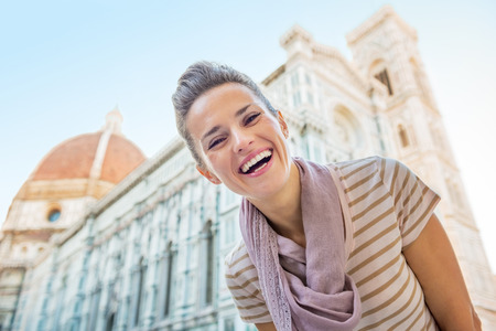 cattedrale: Portrait of happy young woman in front of cattedrale di santa maria del fiore in florence, italy