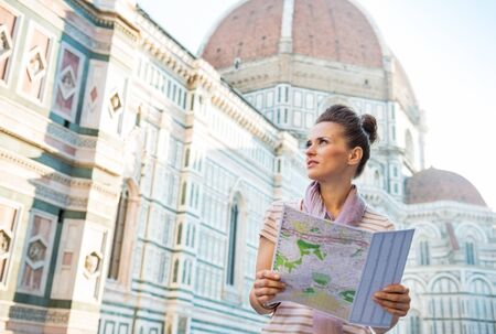 cattedrale: Young woman with map in front of cattedrale di santa maria del fiore in florence, italy
