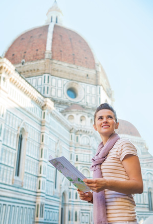 cattedrale: Portrait of happy young woman with map near cattedrale di santa maria del fiore in florence, italy