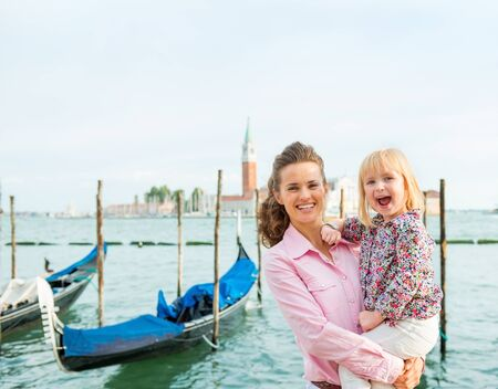 Big smiles for daddy... This little girl is thrilled to be in Venice with her parents. Gondola rides are so much fun.