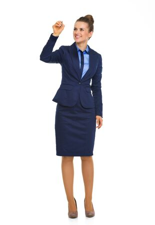midair: A happy businesswoman smiles as she draws in mid-air, showing how she has gone from success to success in her project.