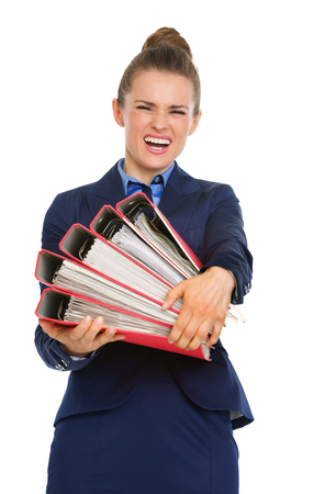 That moment when you realize that success can be quite heavy to carry! Here, a businesswoman struggles to carry files full of papers.