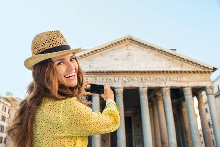 broadly: A happy woman tourist is smiling broadly, taking a photo of the Pantheon. Stock Photo