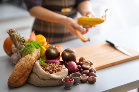 The bounty of the Autumn abounds in this photo, with sweet potato, nuts, cranberries, garlic, corn, red onions, and mini pumpkins on the menu for a delicious dish...