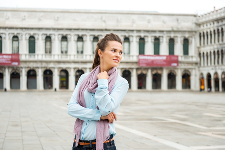 vecchie: A woman, deep in thought, looks over her shoulder at all the surrounding beauty and grandeur of an empty St. Marks Square in Venice. What a rare privilege.