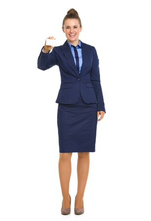 courtesy: A happy business woman in a blue skirt-suit smiles as she holds up her business card.