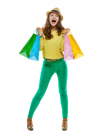 rejoicing: Colourful shopping vibes. Full length portraits of happy brunette woman in hat and bright clothes with shopping bags rejoicing