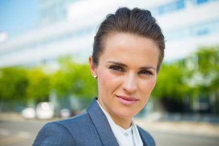 business trends: Into the ultra-modern business trends. Portrait of business woman in modern office district