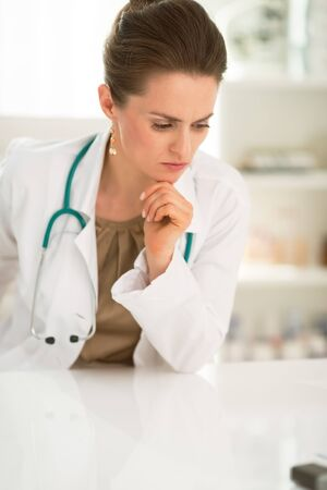 disquieted: Modern health care. Portrait of concerned female doctor in the office Stock Photo