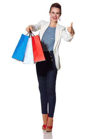 the french way: Shopping. The French way. Full length portrait of happy young woman showing French flag colours shopping bags and thumbs up on white background Stock Photo