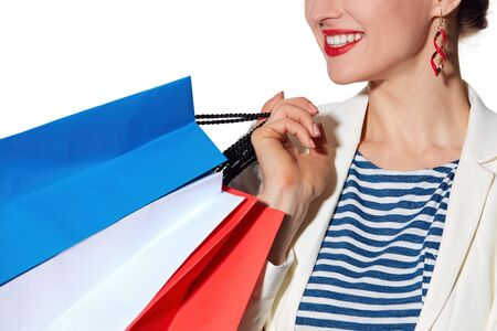 the french way: Shopping. The French way. Closeup on smiling young woman with French flag colours shopping bags
