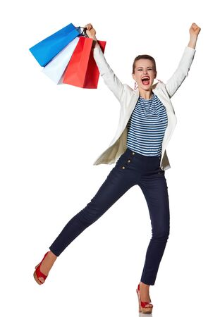 the french way: Shopping. The French way. Full length portrait of happy young woman with French flag colours shopping bags on white background rejoicing