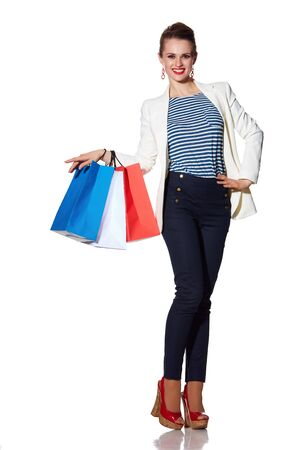the french way: Shopping. The French way. Full length portrait of happy young woman with French flag colours shopping bags posing on white background Stock Photo
