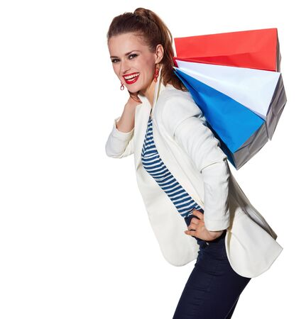 the french way: Shopping. The French way. Happy young woman with French flag colours shopping bags on white background