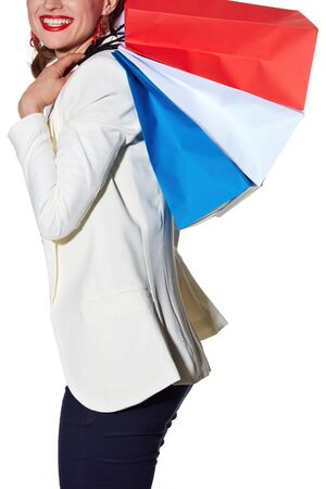 the french way: Shopping. The French way. Closeup on happy young woman with French flag colours shopping bags on white background