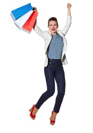 the french way: Shopping. The French way. Full length portrait of happy young woman with French flag colours shopping bags jumping against white background