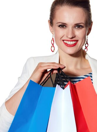 the french way: Shopping. The French way. Close portrait of happy young woman with French flag colours shopping bags on white background