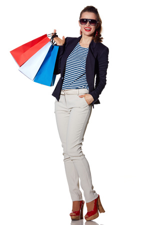 the french way: Luxury Shopping. The French way. Full length portrait of smiling young woman with shopping bags in sunglasses posing on white background Stock Photo