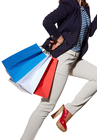 the french way: Luxury Shopping. The French way. Closeup on cheerful young woman with shopping bags in sunglasses posing on white background Stock Photo