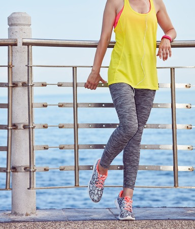 Look Good, Feel great! Closeup on young woman in fitness outfit looking into the distance at the embankment