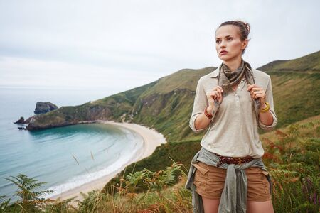 Into the wild in Spain. adventure woman hiker in front of ocean view landscape Stock Photo