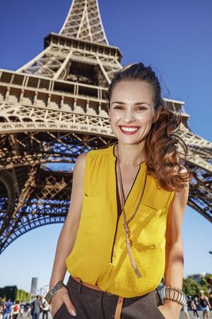 touristy: Touristy, without doubt, but yet so fun. Portrait of happy young woman against Eiffel tower in Paris, France Stock Photo