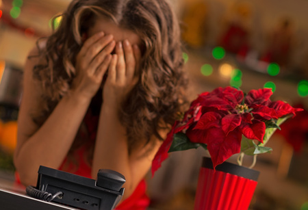 stressful: Christmas can be a stressful holiday. Frustrated woman waiting for a phone call.