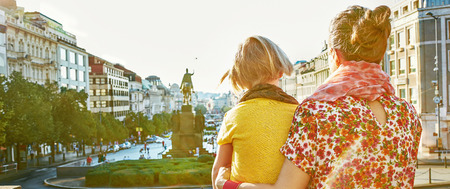 The spirit of old Europe in Prague. Seen from behind young mother and daughter tourists on Vaclavske namesti in Prague, Czech Republic exploring attractions