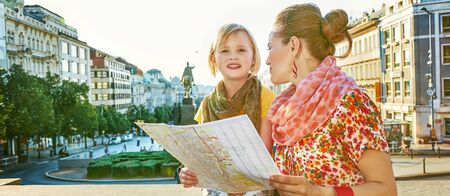 mam: The spirit of old Europe in Prague. happy young mother and child travellers on Wenceslas Square in Prague, Czech Republic with map
