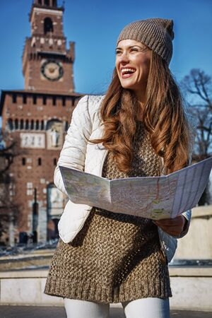 sforzesco: Rediscovering things everybody love in Milan. happy young tourist woman in Milan, Italy with map