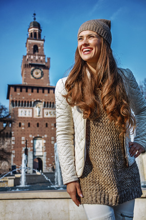 sforza: Rediscovering things everybody love in Milan. Portrait of smiling trendy tourist woman near Sforza Castle in Milan, Italy