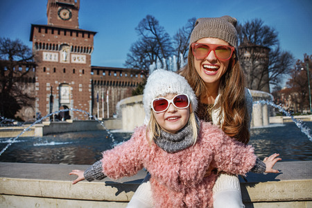sforza: Rediscovering things everybody love in Milan. Portrait of smiling modern mother and daughter tourists in sunglasses in Milan, Italy having fun time Editorial