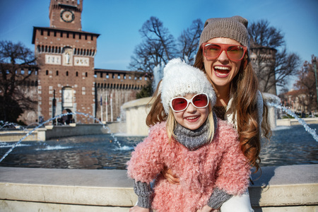 sforza: Rediscovering things everybody love in Milan. Portrait of smiling modern mother and child travellers in sunglasses in Milan, Italy